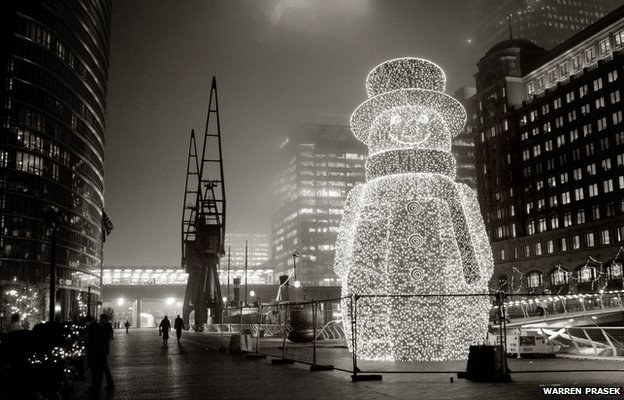 Canary Wharf Snowman, London by Warren Prasek