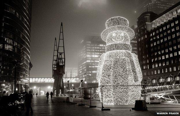 Canary Wharf Snowman, London by Warren Prasek