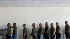 Border police recruits stand in a queue in a dining room at the Meteti Police base in the Darien province