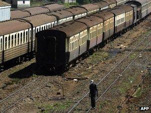 Man walking in Nairobi railway yard