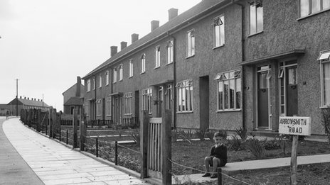 1949: A young boy sitting on a step outside his house in Arrowsmith Road. (Photo by Chaloner Woods/Getty Images)