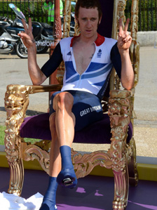 Bradley Wiggins sitting in a victory throne at Hampton Court