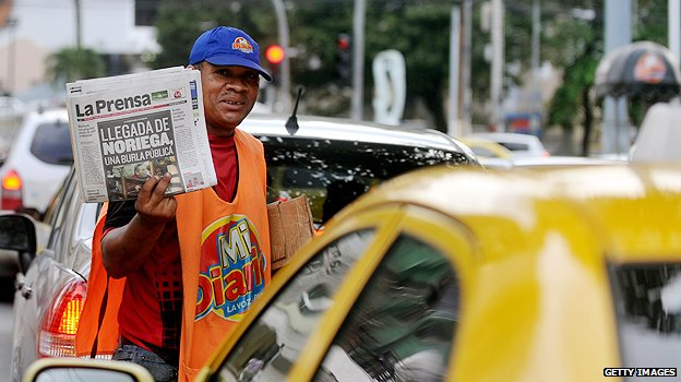 Newspaper vendor in Panama
