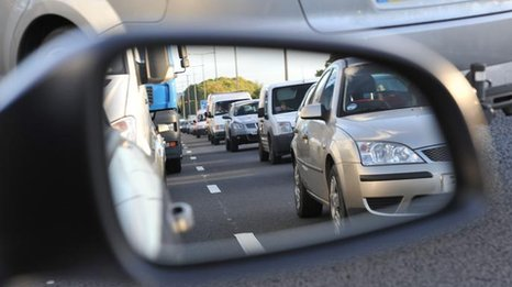 Traffic jam viewed through a wing mirror