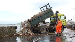 Rubble being tipped onto a coast road