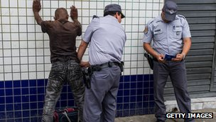 Military policemen frisk a suspect in downtown Sao Paulo