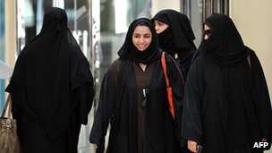 Saudi women walk inside the Faysalia mall in Riyadh City, on September 26, 2011,