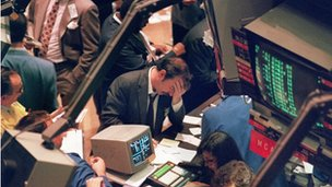 19 October 1987. A trader holding his head at the floor of the New York Stock Exchange when the Dow Jones dropped over 500 points, the largest decline in modern time, as panic selling swept Wall Street. 