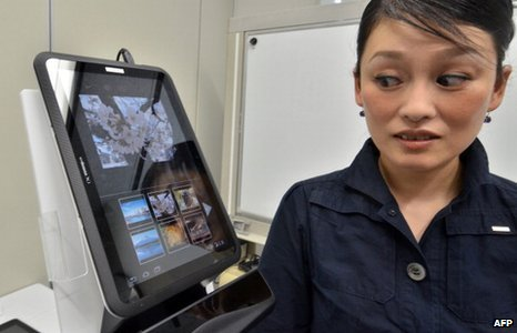 An employee from NTT DoCoMo demonstrates the prototype model of a new hands-free tablet operated by eye-controled input