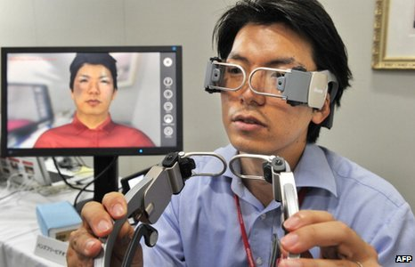 A researcher from NTT DoCoMo demonstrates a prototype model of a hands-free videophone