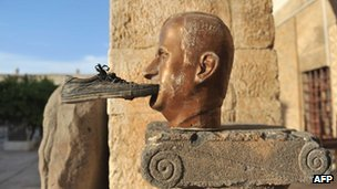A shoe is seen glued to a statue of late Syrian president Hafez al-Assad, at the museum of Maaret al-Numan, in the north-western Idlib province, 17 October 2012