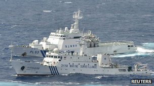 A Chinese marine surveillance ship cruises next to a Japan Coast Guard patrol ship in the East China Sea