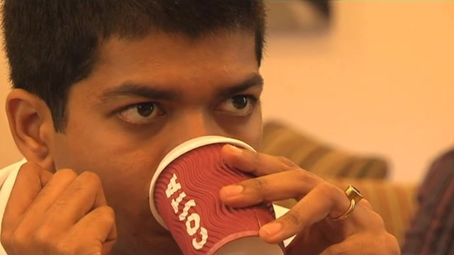 Indian coffee-drinker drinking Costa coffee