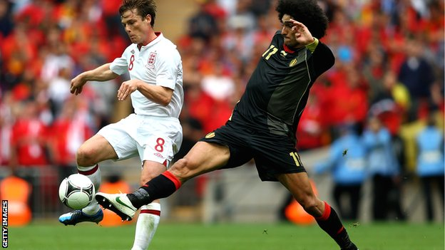 Scott Parker (left) tussles with Belgium's Marouane Fellaini