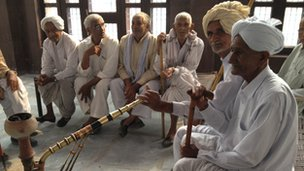 Men smoking pipes in the rural district of Jind, a short drive from Delhi