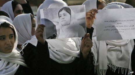 Afghan students express their support for Malala Yousafzai outside their school in Herat