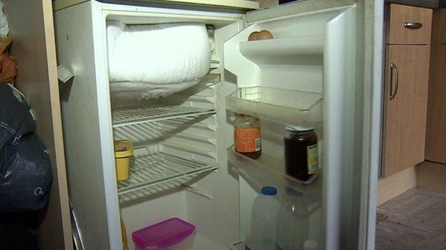 Couple's empty fridge