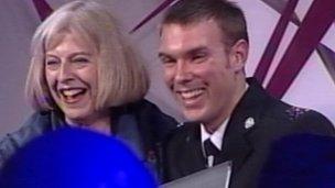 PC Stypulkowski receives his award from Home Secretary Theresa May