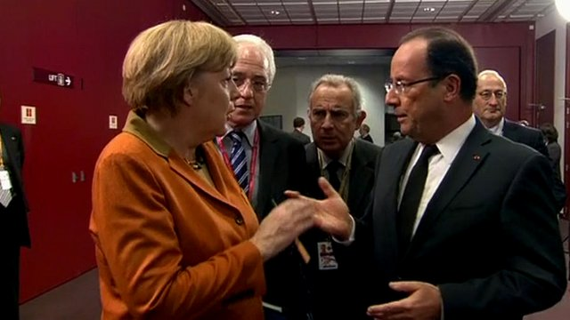 Angela Merkel and Francois Hollande talking