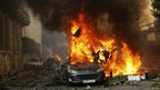 A car burns at the site of an explosion in Beirut, Lebanon