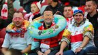 Polish fans wear aquatic equipment before the Fifa 2014 World Cup qualifying football match Poland v England