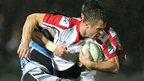 Glasgow's Alex Dunbar tackles Ulster wing Tommy Bowe at a rain-lashed Scotstoun on Friday night