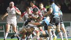 Ulster number eight Nick Williams feels the force of Al Kellock's tackle