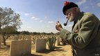 British veteran Peter Watson, 93, smokes a pipe near war graves at El Alamein, 20 October