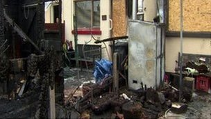 The scene at the rear of the house following an arson attack last week