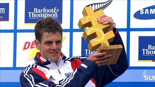 Jonny Brownlee lifts the trophy