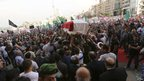 Members of the Internal Security Forces carry the coffin of intelligence officer Wissam al-Hassan through Beirut