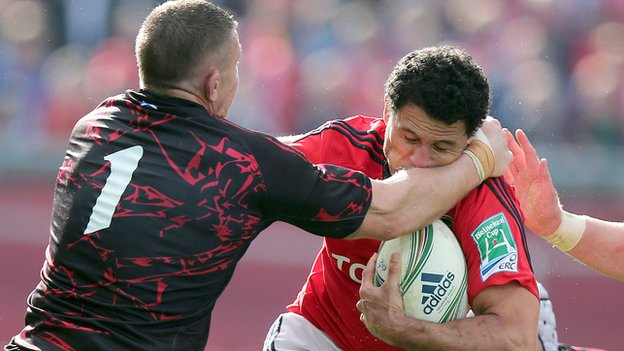 Edinburgh prop John Yapp tackles Munster winger Dougie Howlett at Thomond Park