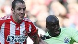John O'Shea (left) and Demba Ba