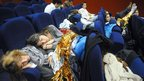 Evacuees sleep at the Palais des Sports in Lourdes, 20 October