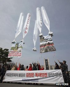 Activists launch balloons carrying leaflets at Imjingak pavilion in Paju, north of Seoul in this 15 April, 2012 file photo
