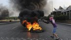 A Sunni Muslim protester burns tyres blocking a road in Beirut, 20 October 2012.