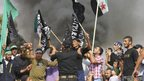 Syrian opposition and Islamist flags are waved during a protest in north Lebanon, a day after a car bomb killed a top intelligence officer and two others in Beirut, 20 October 2012.