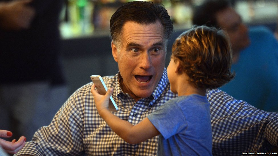 US Republican presidential candidate Mitt Romney talks with grandson Miles