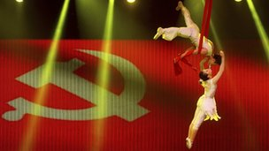 Acrobats and Chinese flag