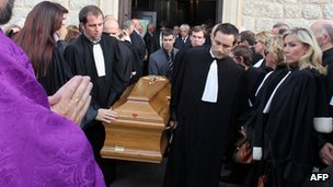 Lawyers carrying the coffin of their murdered Corsican colleague, Antoine Sollacaro