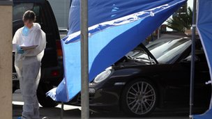 A forensic scientist beside the car in which Antoine Sollacaro was murdered