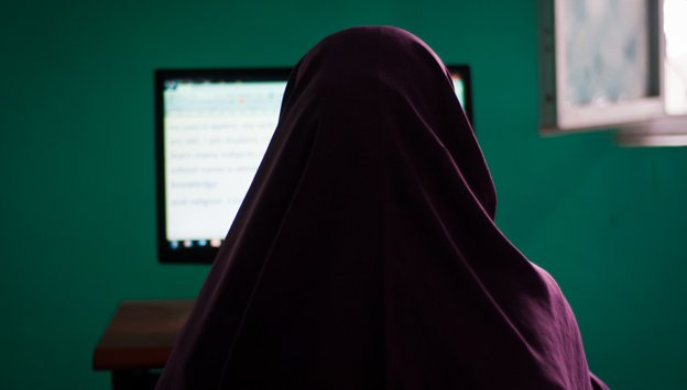Somali woman uses a PC