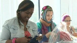 Students removing logos from counterfeit clothes