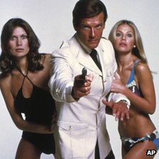 Maud Adams, Roger Moore and Britt Ekland from the 1974 film The Man with the Golden Gun