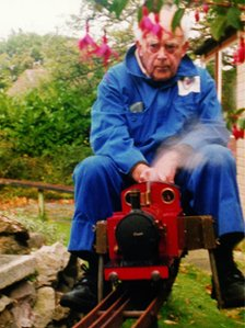 Old photo: Harold Barton rides the miniature tank engine