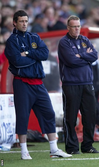 Ross (left) on the sidelines with Adamson as the Sons head for play-off victory