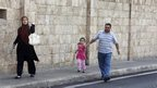 Family in Beirut walk away from clashes between Lebanese army and Sunni gunmen (22 October)