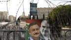 Poster showing Gen Wissam al-Hassan and former PM Rafik Hariri, Beirut (22 Oct)