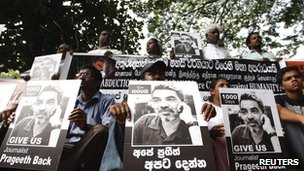 Demonstrators hold placards with an image of missing cartoonist and columnist Prageeth Eknaligoda, during a protest in front of the United Nations head office in Colombo