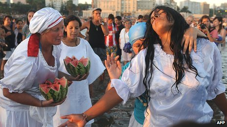 People celebrate a ritual honouring Iemanja, the goddess of the sea in the Umbanda religion